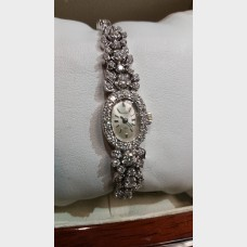 Ladies 14kt white gold & diamond Bulova Watch (Store Special)