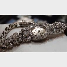 Ladies 14kt white gold & diamond Bulova Watch (Store Special)