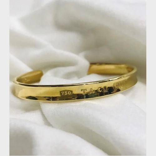 5cd1ac28220cb Tiffany & Co. 18K 1837 Cuff Bracelet